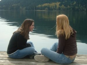 photo-two-girls-talking-on-dock-1